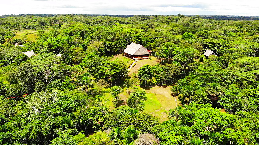 Aerial sweeping view of the Lakshmi Amazon River Lodge