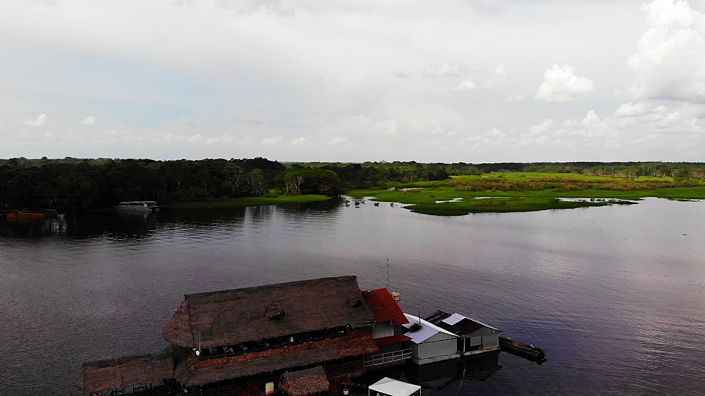 Aerial drone shot of Al Frio y Al Fuego floating restaurant in the Amazon River, Iquitos, Amazon, Peru, South America - 1218-1269
