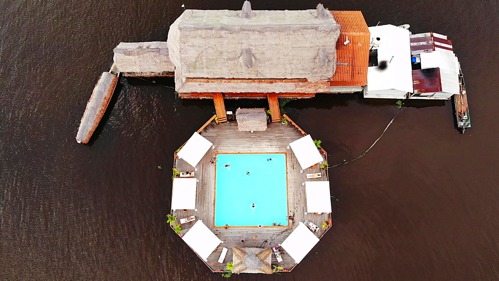Aerial drone shot of Al Frio y Al Fuego floating restaurant in the Amazon River, Iquitos, Amazon, Peru, South America - 1218-1272