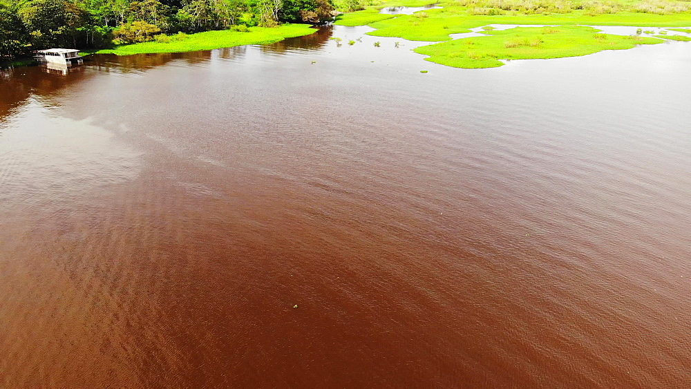 Aerial drone shots of Al Frio y Al Fuego floating restaurant in the Amazon River