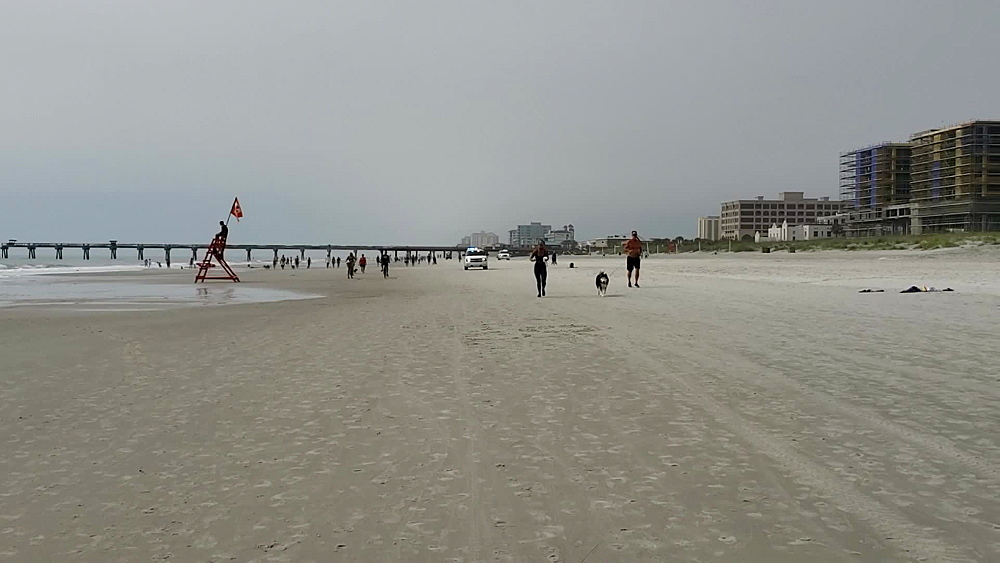 Cops patrolling busy Jacksonville Beach during COVID-19 Pandemic, Jacksonville, Florida, United States of America, North America