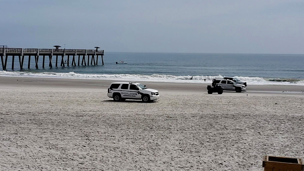Cops sweeping busy Jacksonville Beach during COVID-19 Pandemic, Jacksonville, Florida, United States of America, North America - 1218-1302
