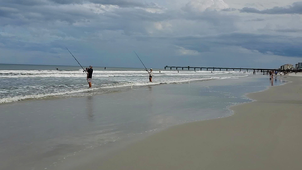 Couple fishing at Jacksonville Beach during COVID-19 Pandemic, Jacksonville, Florida, United States of America, North America