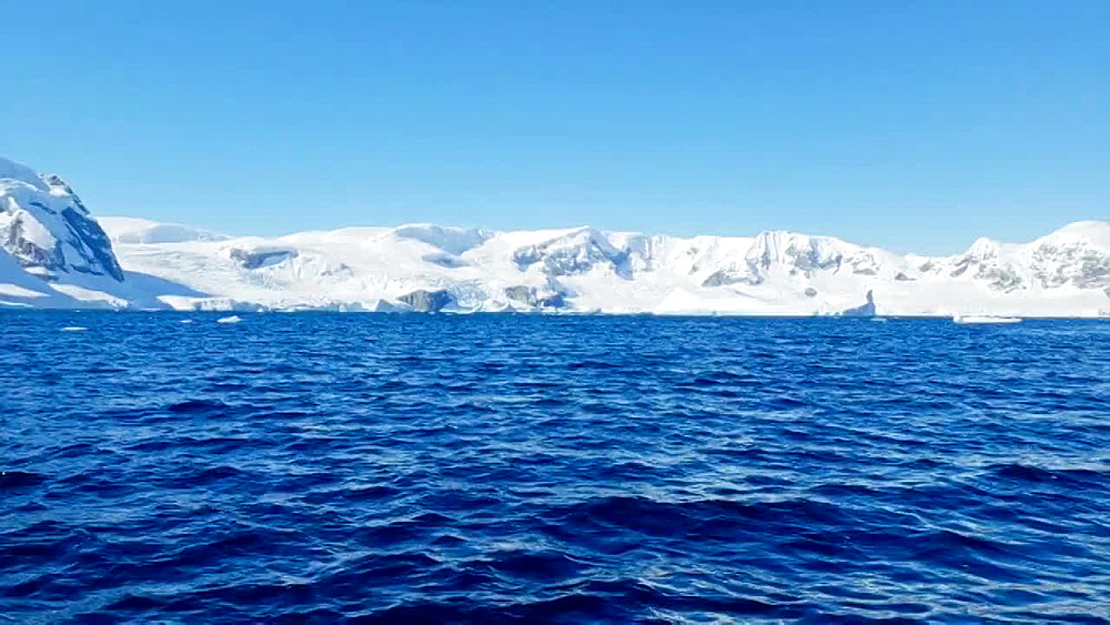 Scenic view of the icebergs and glaciers across the water of Antarctica, Polar Regions - 1218-918