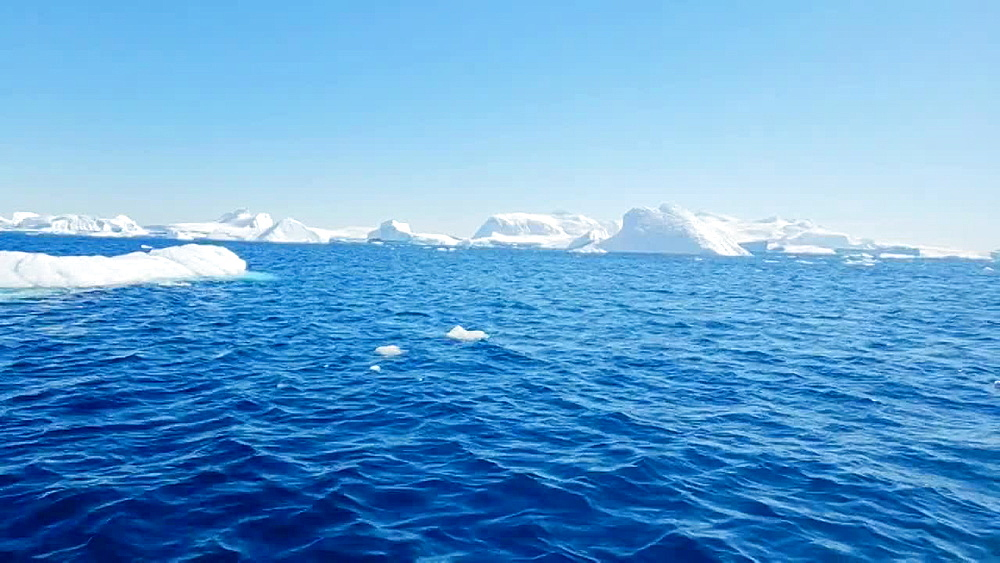 Scenic view of the icebergs and glaciers across the water of Antarctica, Polar Regions - 1218-919