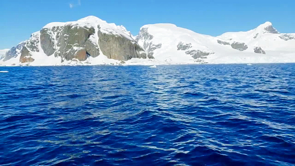 Scenic view of the icebergs and glaciers across the water of Antarctica, Polar Regions - 1218-921