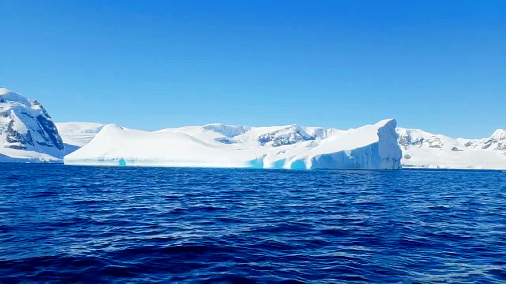 Scenic view of the icebergs and glaciers across the water of Antarctica, Polar Regions