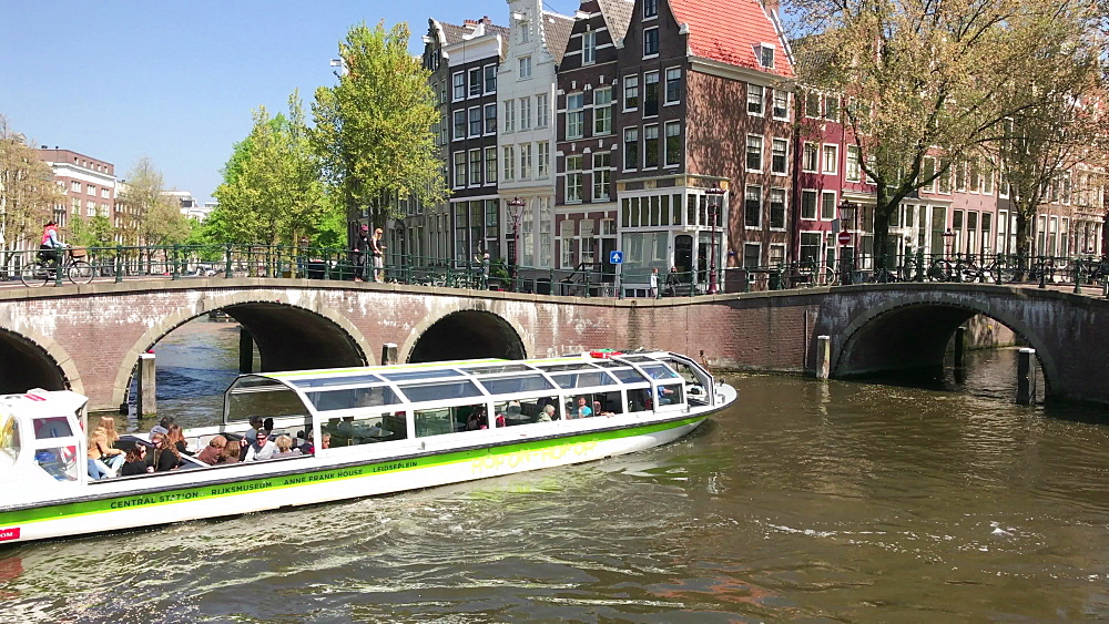 Tour boat on Keizersgracht Canal in Amsterdam, North Holland, Netherlands, Europe
