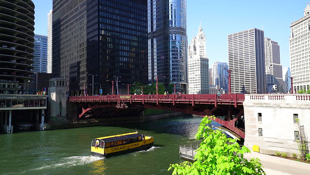 Water taxi passes under State Street Bridge on Chicago River, Chicago, Illinois, United States of America, North America