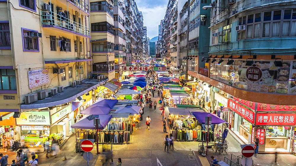 Time lapse of street market in Mong Kok at dusk, Kowloon, Hong Kong, China, Asia