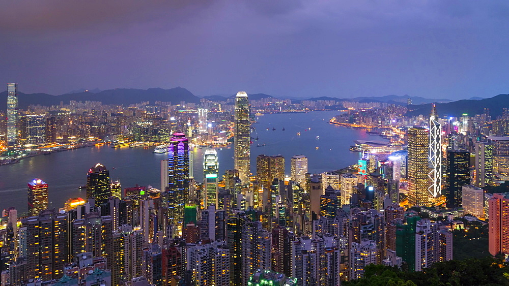 Hong Kong skyline from Victoria Peak, day to night time lapse, Hong Kong, China, Asia