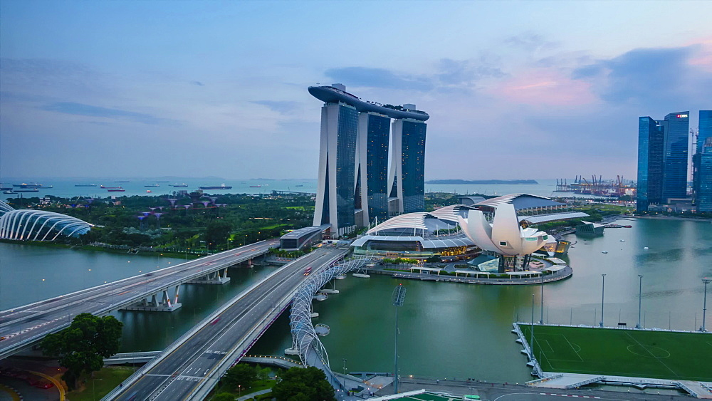 Day to night time lapse of traffic on Benjamin Sheares Bridge to Marina Bay Sands Hotel, Singapore, Southeast Asia, Asia - 1226-995