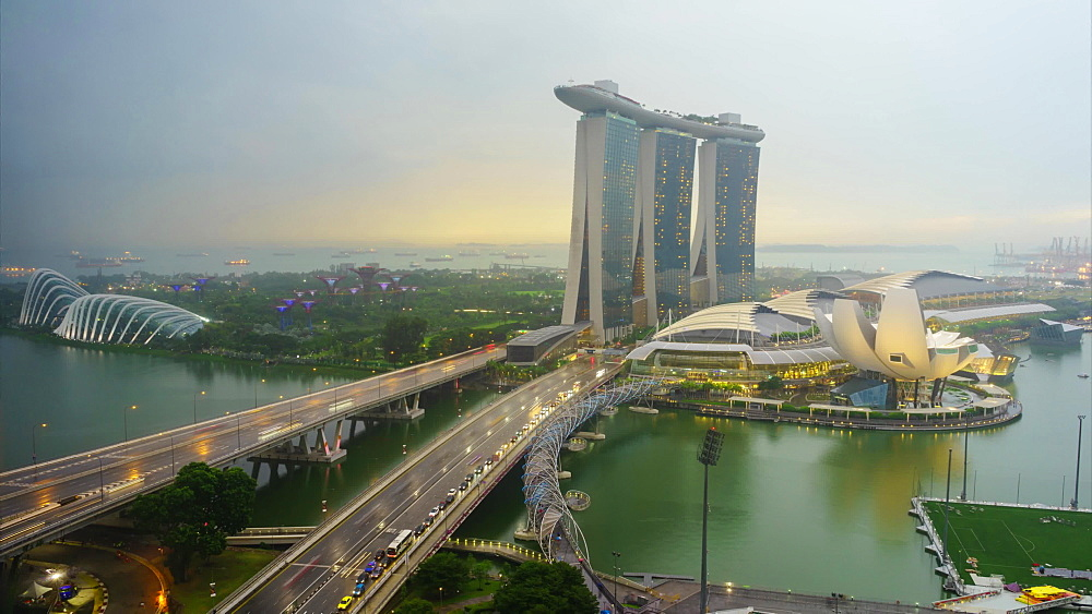 Day to night time lapse of traffic on Benjamin Sheares Bridge to Marina Bay Sands Hotel, Singapore, Southeast Asia, Asia