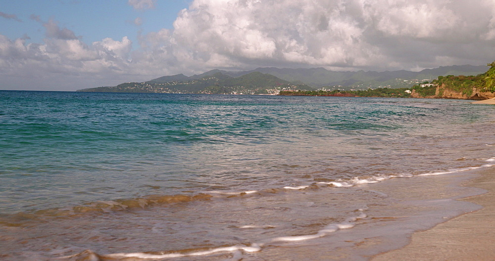 Waves lapping the shore on Magazine Beach, Grenada, West Indies, Caribbean, Central America