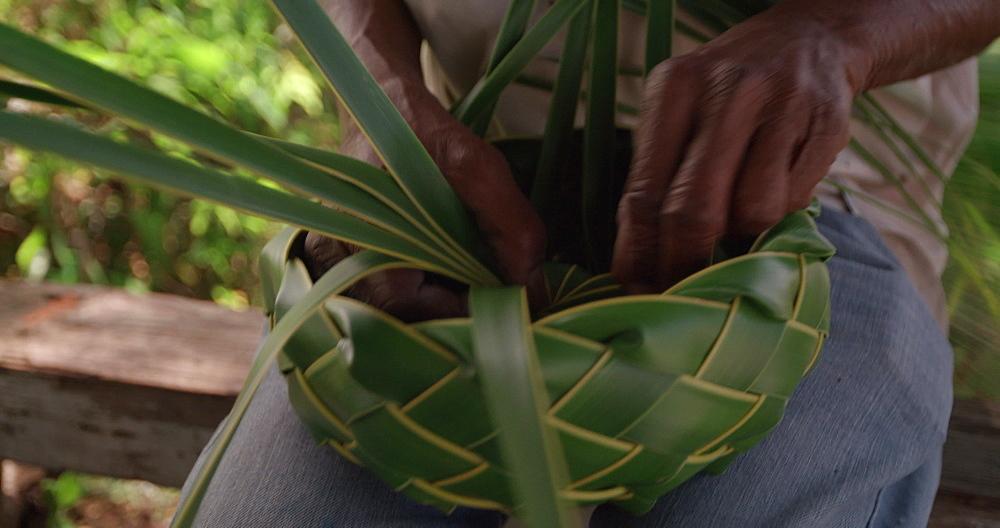 Basket being weaved on Grand Anse Beach, Grenada, Caribbean, West Indies.