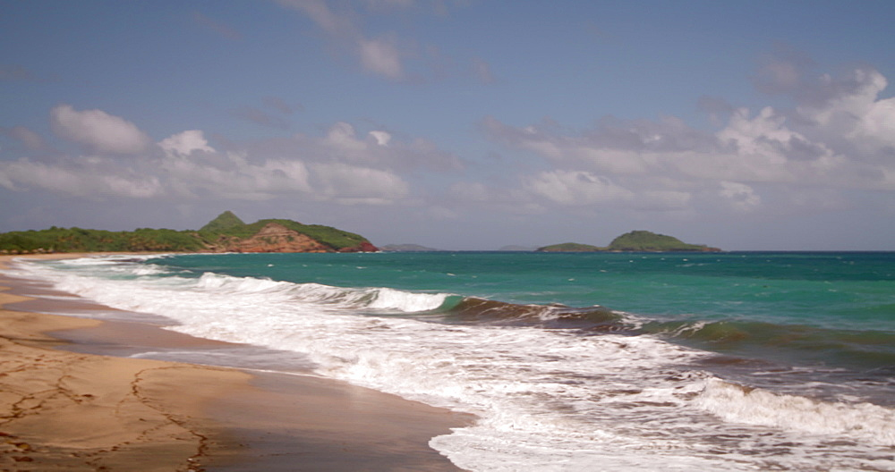 Waves lapping the shore at Levera Beach, Grenada, Caribbean, West Indies.