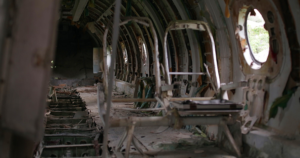Inside of abandoned Cuban plane at Pearls Airport, Grenada, West Indies, Caribbean, Central America