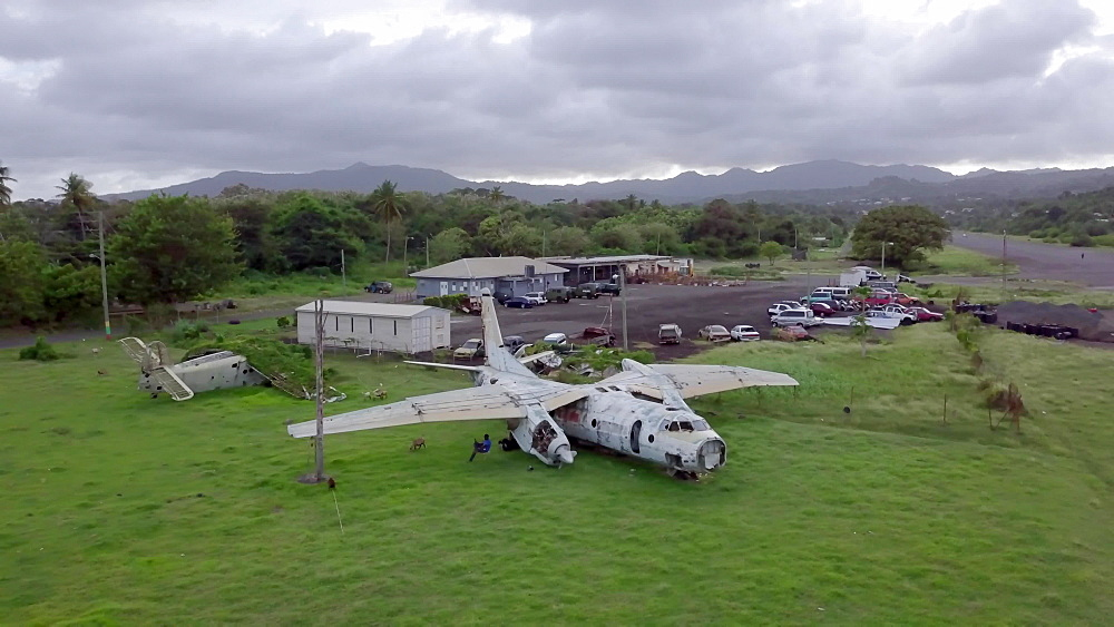 Drone aerial view of abandoned Cuban plane at Pearls Airport, Grenada, West Indies, Caribbean
