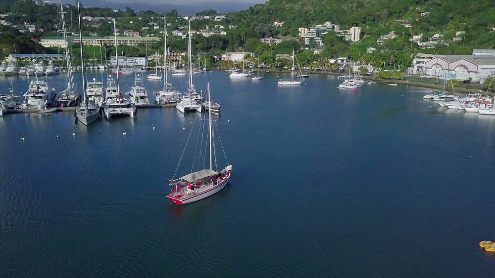 Traditional sloop boat sailing out the harbour, St. George''s, Grenada, West Indies, Caribbean, Central America