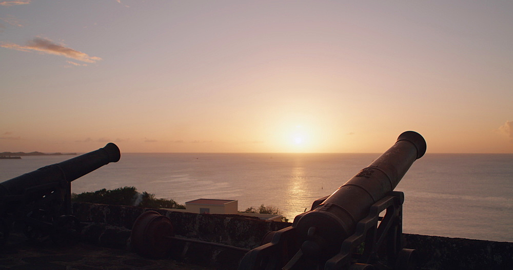 Canons at Fort George looking out over the Caribbean Sea at sunset, St George?s, Grenada, West Indies, Caribbean