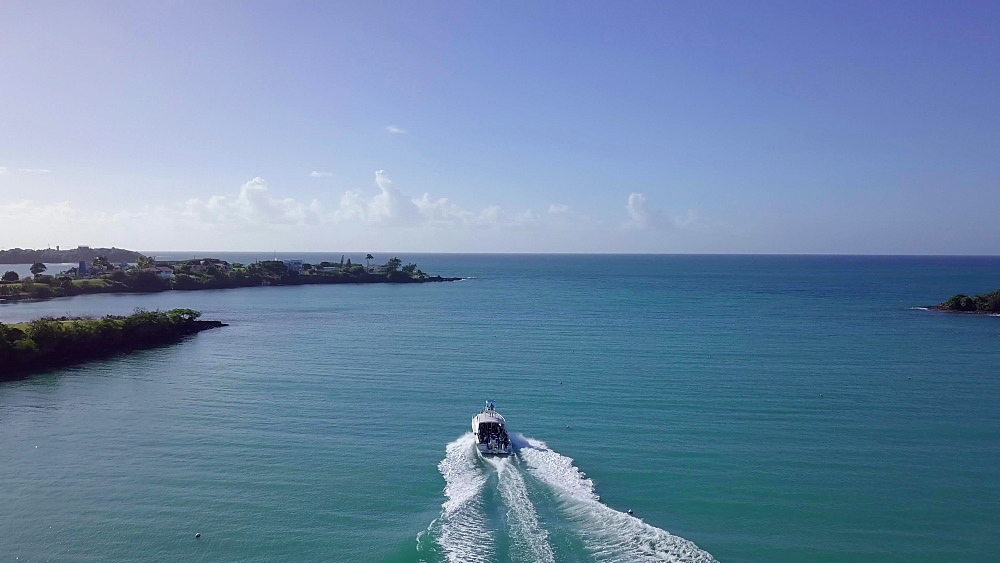 Drone aerial footage of boats sailing out from True Blue Bay, Grenada, West Indies, Caribbean