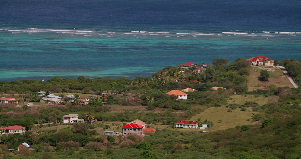View of Carriacou houses and Caribbean Sea, Carriacou, Grenada, West Indies, Caribbean, Central America