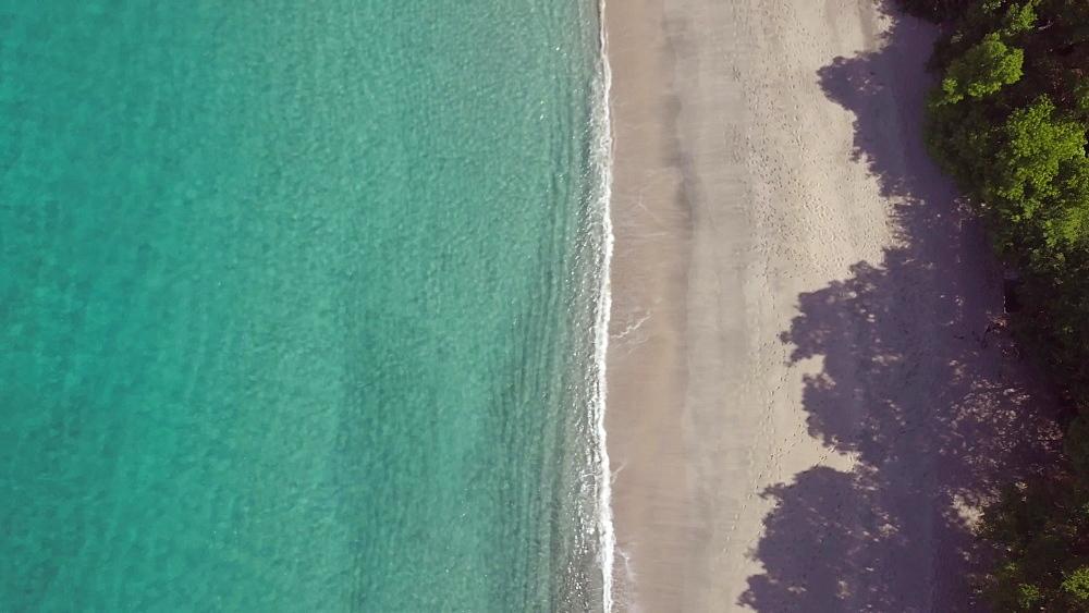 Drone shot of Caribbean Sea and Anse le Roche Beach, Carriacou, Grenada, Caribbean.