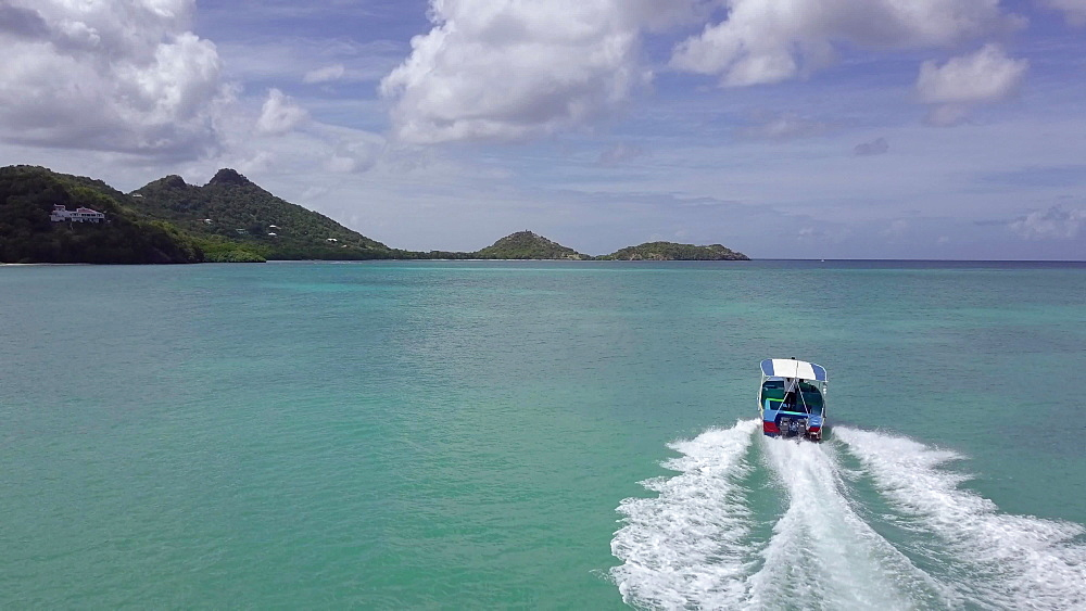 tour boat drone tracking shot, Paradise beach, carriacou, Grenada, Caribbean
