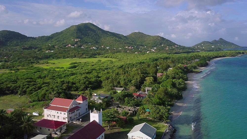 Drone pedestal shot rising above Hillsborough Town, Carriacou, Grenada, Caribbean.
