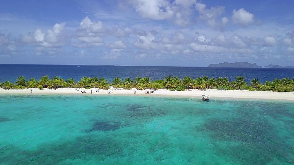 Aerial Drone Shot tracking along Sandy Island Beach, Carriacou, Grenada, Caribbean