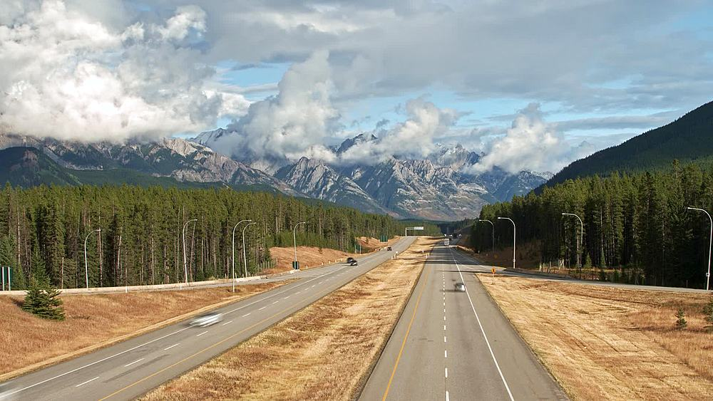 Timelapse of Trans Canada Highway 1 and Rocky Mountains near Banff, Banff National Park, Alberta, Canada, North America