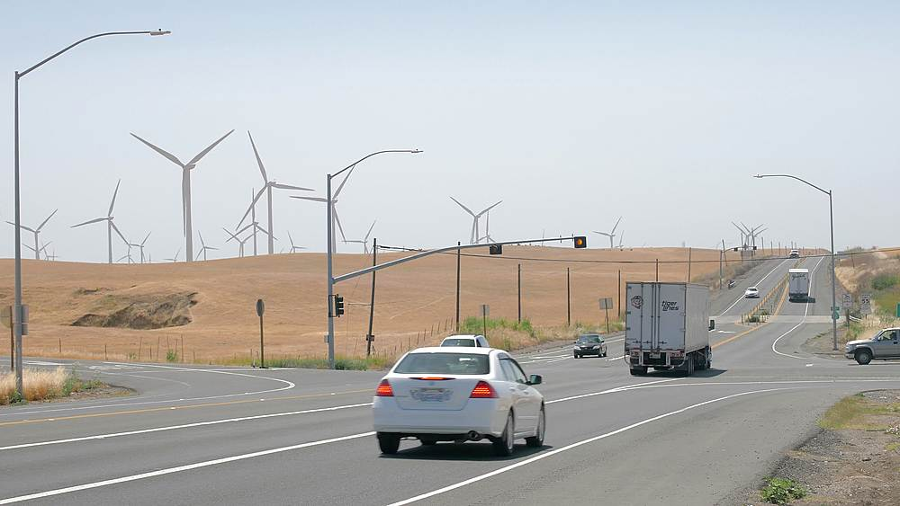 View of busy traffic and wind generator farm near Moccasin, California, United States of America, North America