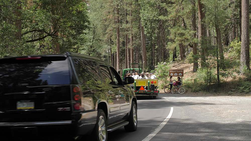 Tourists travelling through Yosemite Valley, Yosemite National Park, UNESCO World Heritage Site, California, USA, North America