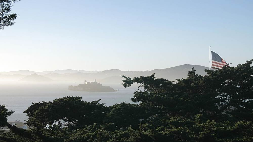 Foggy Sunset over Alcatraz Island from Coit Tower, San Francisco, California, United States of America, North America