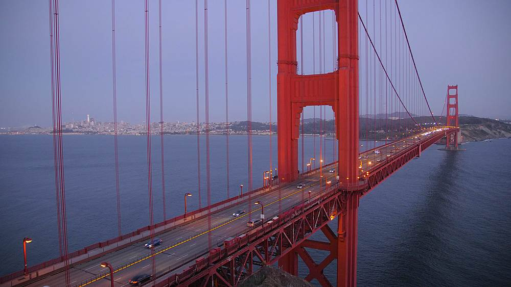 Still shot of the Golden Gate Bridge and city in background at dusk, San Francisco, California, United States of America, North America