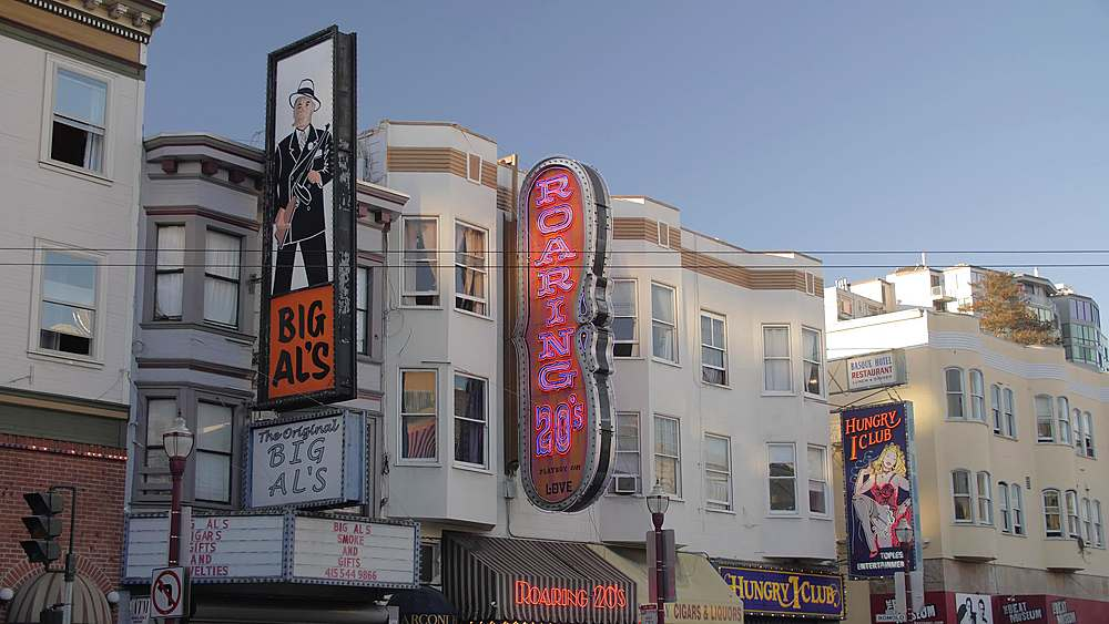 Busy Columbus Avenue and clubs signs on buildings in North Beach district at sunset, San Francisco, California, United States of America, North America - 1276-1338