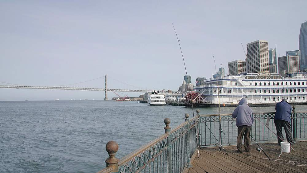 Fisherman on Pier 7 and San Francisco skyline, California, United States of America, North America - 1276-1345