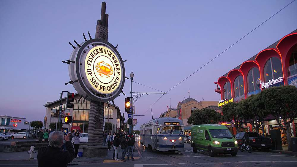 View of Fishermans Wharf sign and a passing tram at dusk, San Francisco, California, United States of America, North America - 1276-1375