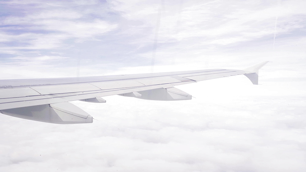 Video of airplane's wing above the clouds, Unitted kingdom