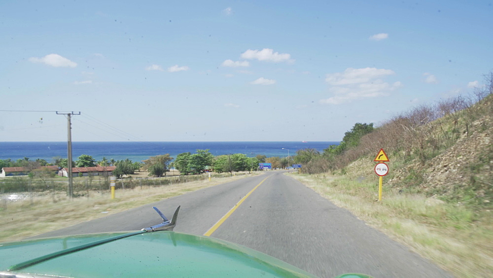 View from an old vintage car on a highway near Cienfuegos, Cuba, West Indies, Caribbean, Central America