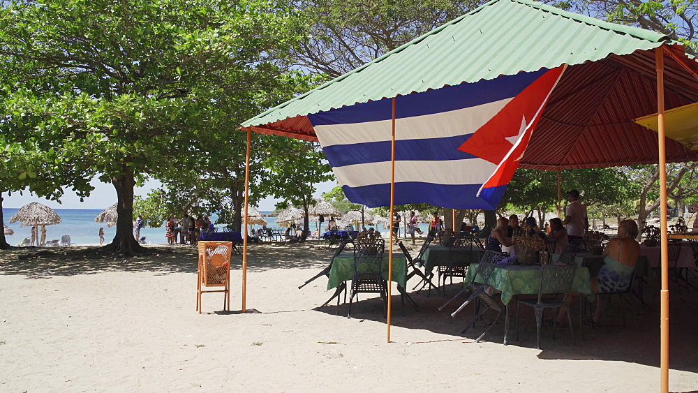 Huge Cuban flag at Playa Rancho Luna, Cienfuegos, Cuba, West Indies, Caribbean, Central America