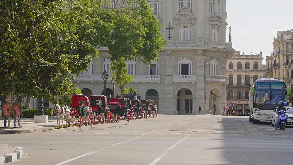 Multiple horse chariots parked in Havana, La Habana, Cuba, West Indies, Caribbean, Central America