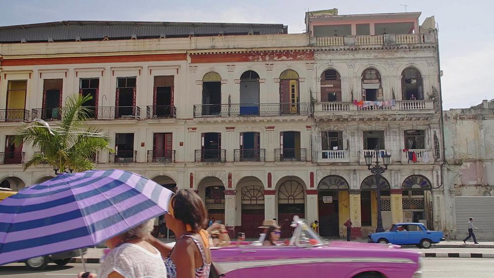 Busy traffic near El Capitolio in La Habana (Havana), Cuba, West Indies, Caribbean, Central America