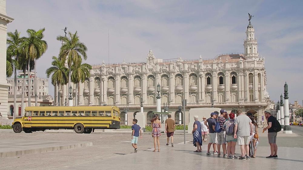 El Capitolio and yellow American school bus in La Habana (Havana), Cuba, West Indies, Caribbean, Central America
