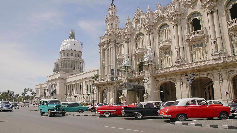 Old American cars parked near the Gran Teatro de La Habana and El Capitolio in Havana, Cuba, West Indies, Caribbean, Central America