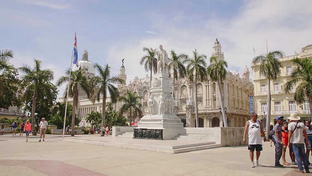 Cuban flag and Statue Estatua a Jose Marti in Parque Central, The Gran Teatro de La Habana, El Capitolio, Havana, Cuba, West Indies, Caribbean, Central America