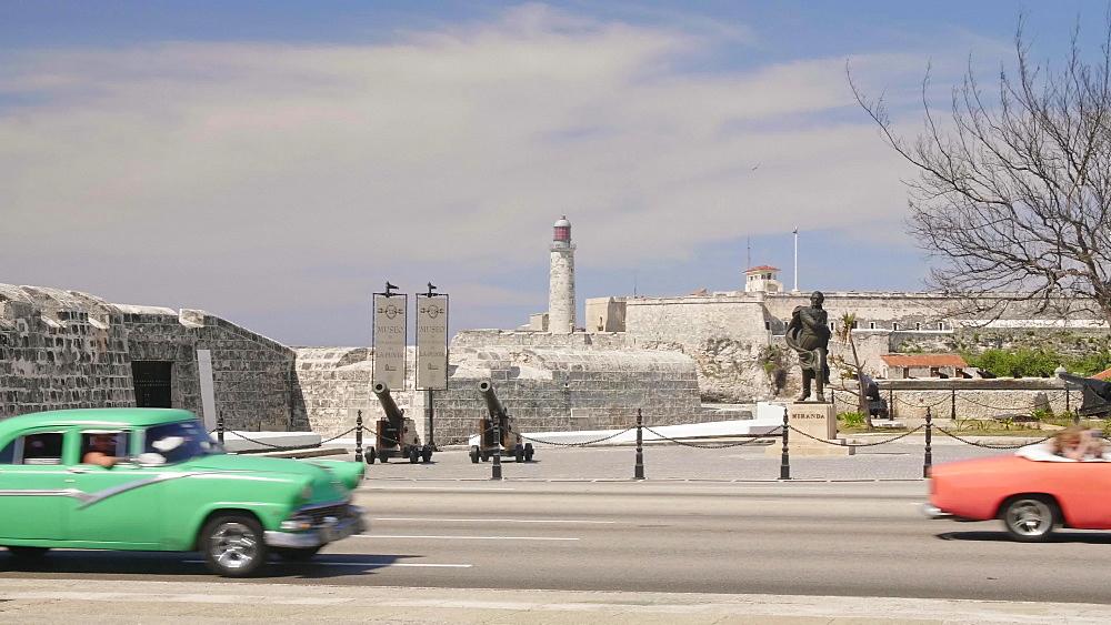 Busy traffic in front of Castillo de San Salvador de la Punta and Castillo del Morro, Havana, Cuba, West Indies, Caribbean, Central America