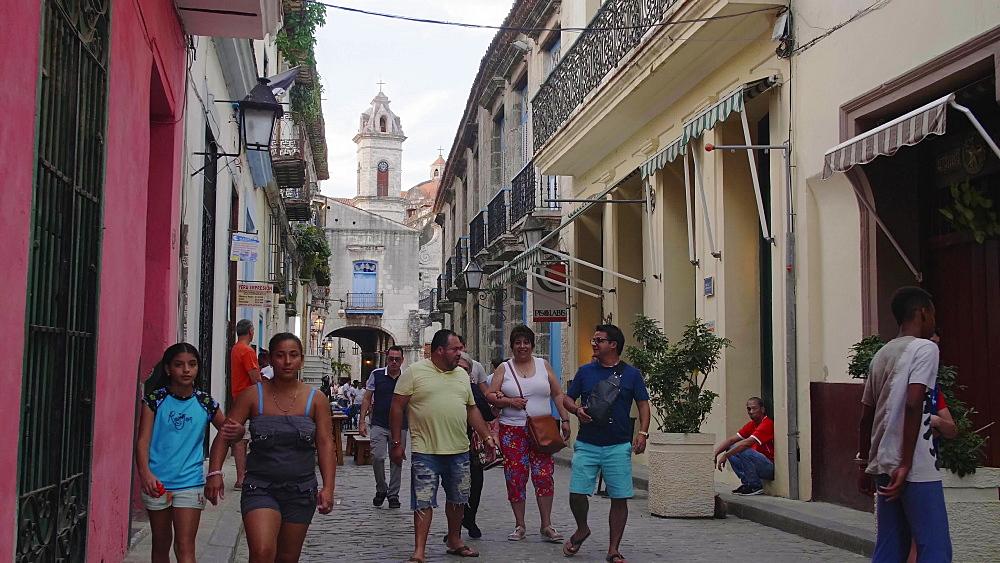 Busy street near La Catedral de la Virgen Maria in La Habana Vieja, UNESCO, Plaza de la Catedral, Old Havana, Cuba, West Indies, Caribbean, Central America