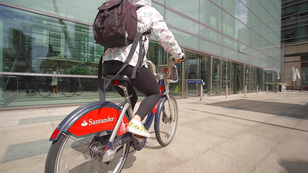 Santander city bike riding through Canary Wharf, Docklands, London, England, United Kingdom, Europe