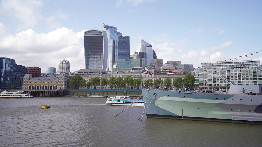 HMS Belfast, WW2 battleship now a floating museum, on the River Thames and London skyline, London, England, United Kingdom, Europe